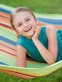 Summer, rest in the garden - lovely girl in colorful hammock — Stock Photo