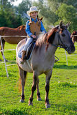 Horseback riding - lovely cowgirl is riding a horse — Stock Photo