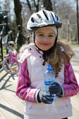 Spring biking - Lovely cyclist on the tour in the park — Stock Photo