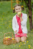 Gardening, orchard - lovely girl is eating ripe pear — Stock Photo