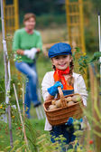 Gardening - lovely girl with mother working in vegetable garden — Foto Stock