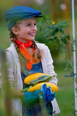 Gardening, gardener, child - lovely girl with picked vegetables — Photo