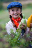 Gardening, gardener, child - lovely girl with picked vegetables — Stock Photo