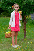 Fruits orchard, garden - lovely girl eating picked ripe pear — Stock Photo