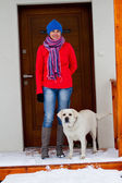 Winter walk with dog - Portrait of woman with dog in front of the house — Foto Stock