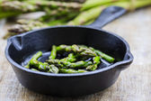 Asparagus on frying pan — Stock Photo