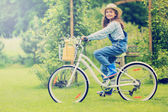 Spring Cycling -  girl with bicycle in spring garden — Stock Photo