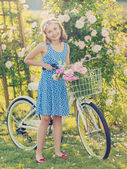 Summer Cycling -  girl with bicycle in summer garden — Stock Photo