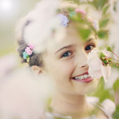 Summer garden - beautiful girl  in the flower garden — Stok fotoğraf
