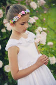 Rose garden - beautiful girl playing in the rose garden — Stock Photo