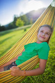 Summer joy  - lovely girl in hammock  in the garden — Stok fotoğraf