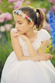 Summer garden - beautiful girl  in the flower garden — Stock Photo