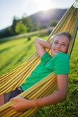 Summer joy  - lovely girl in hammock  in the garden — Zdjęcie stockowe