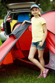 Camp in the tent - young girl on the camping — Stock Photo