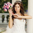 Beautiful bride with bouquet — Stock Photo #26612911