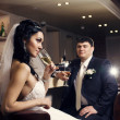 Bride and groom in the lobby. - 图库照片