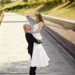 Happy bride and groom in a park — Stock Photo