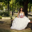 Stock Photo: Beautiful bride in the park