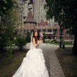 Stock Photo: Happy bride in summer park on background palace
