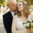 Stock Photo: Wedding shot of bride and groom in park
