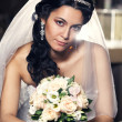 Stock Photo: Beautiful bride with bouquet