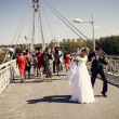 Bride and groom on the bridge - Stock Photo