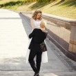 Happy bride and groom in a park — Stock Photo #26613343