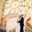 Bride and groom in a church - Stock Photo