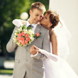 Charming bride and groom on their wedding celebration — Stock Photo #26613363