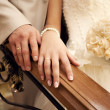 Brides and grooms hands - Stock Photo