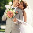 Charming bride and groom on their wedding celebration — Stock Photo #26613561
