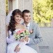 Charming bride and groom on their wedding celebration — Stock Photo #26613595