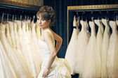 Bride in a wedding store — Stock Photo