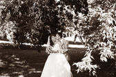 Young Bride and groom posing in park — Stock Photo