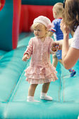 Little girl at the trampoline — Stock Photo
