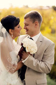 Wedding shot of bride and groom in park — Stock Photo