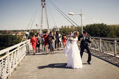 Bride and groom on the bridge — Stock Photo