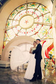 Bride and groom in a church — Stock Photo