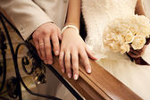 Brides and grooms hands — Stock Photo