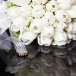 White wedding bouquet on a black background — Stock Photo