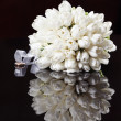 White wedding bouquet on a black background — Stock Photo #26932995