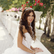 Beautiful smiling bride in park — Stock Photo #30523091