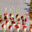 Pineapple and strawberries on skewers — Stockfoto