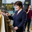 Two happy women shopping in clothes store — Stock Photo #37760717
