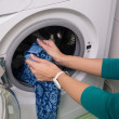Putting a cloth into washing machine — Stok fotoğraf