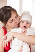 Cheerful young mother and her son — Stock Photo