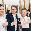 Happy business team with thumbs up — Stock Photo #46332965