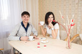 Young couple in the kitchen — Stock Photo