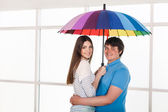 Couple under a umbrella — Stock Photo