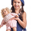 The small beautiful girl with a doll — Stock Photo #50059753
